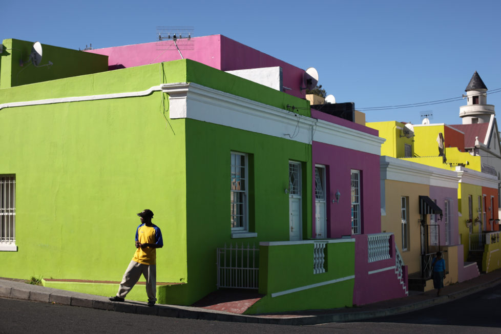 CAPE TOWN, SOUTH AFRICA - OCTOBER 20: A man walks through the Bo-Kaap area of Cape Town on October 20, 2009 in Cape Town, South Africa. The Bo-Kaap area is a predominantly Muslim area of Cape Town with brightly coloured painted houses that line many of the streets.. (Photo by Dan Kitwood/Getty Images)