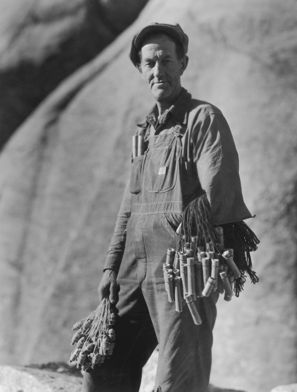 The 'powder monkey' of the Mount Rushmore National Memorial, a sculpture carved into the granite face of Mount Rushmore near Keystone, South Dakota, USA, circa 1930. The 'powder monkey' is holding dynamite and detonators. (Photo by Archive Photos/Getty Images)