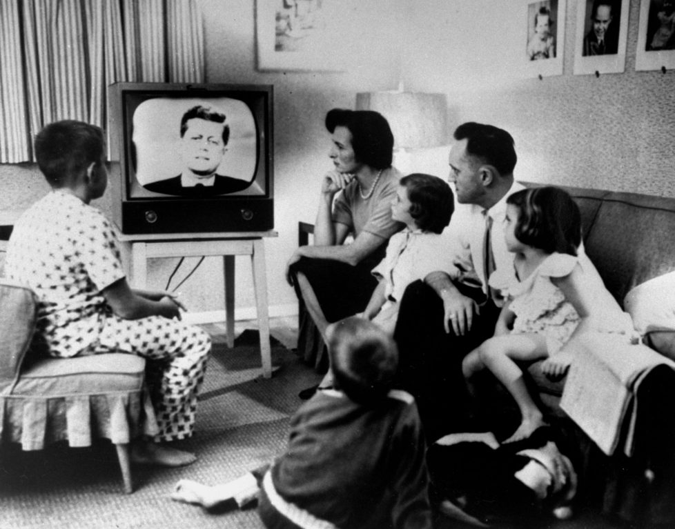 Typical American family gathered around TV, which displays John F. Kennedy's face, to watch debate between Kennedy & Richard Nixon during presidential election. (Photo by Time Life Pictures/National Archives/The LIFE Picture Collection/Getty Images)