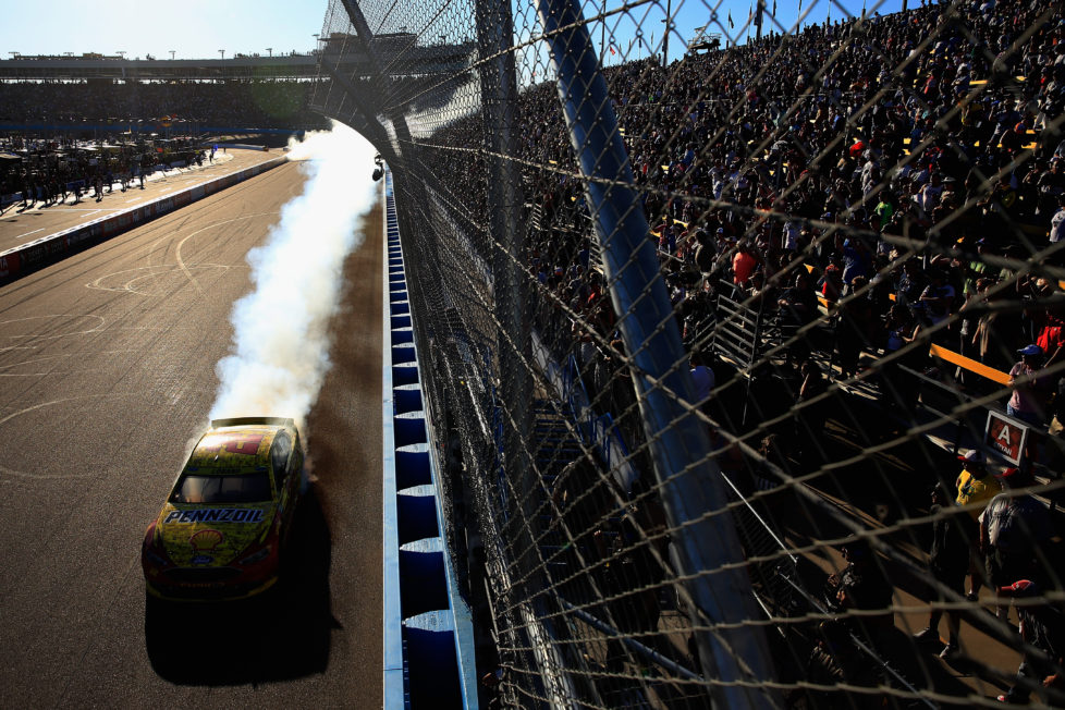 AVONDALE, AZ - NOVEMBER 13: Joey Logano, driver of the #22 Shell Pennzoil Ford, celebrates with a burnout after winning the NASCAR Sprint Cup Series Can-Am 500 at Phoenix International Raceway on November 13, 2016 in Avondale, Arizona. (Photo by Chris Trotman/NASCAR via Getty Images)