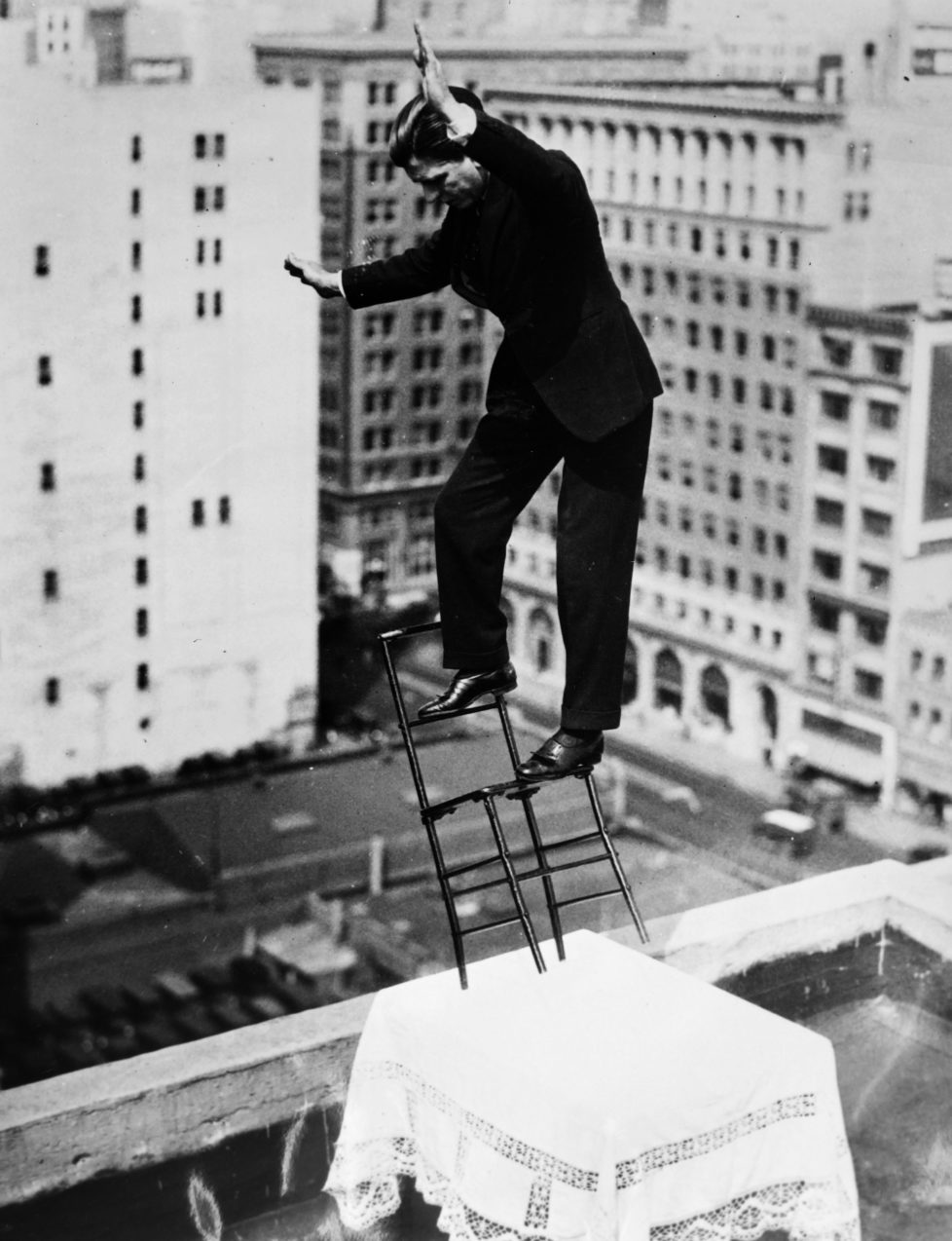 NEW YORK, NY - MARCH 25: French equilibrist Gilbert Bettancourt tests his balance on a chair resting on a table with only two legs, close to the edge of the building roof on March 25, 1932 in New York City. (Photo by Gamma-Keystone via Getty Images)