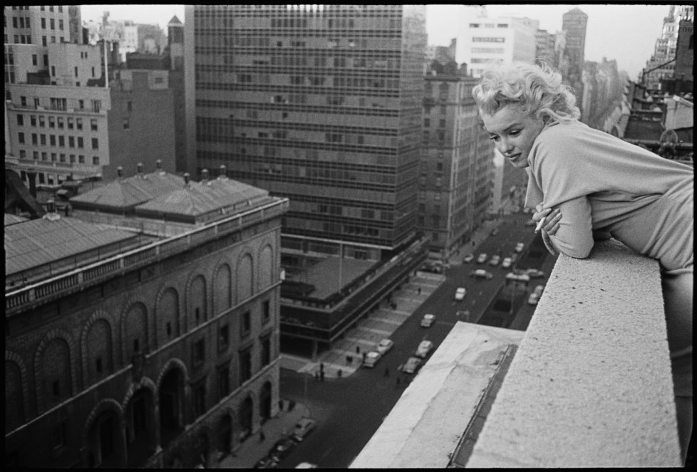 NEW YORK CITY - MARCH 1955: American actress Marilyn Monroe (1926 - 1962) leans over the balcony of the Ambassador Hotel in March 1955 in New York City, New York. (Photo by Ed Feingersh/Michael Ochs Archives/Getty Images)