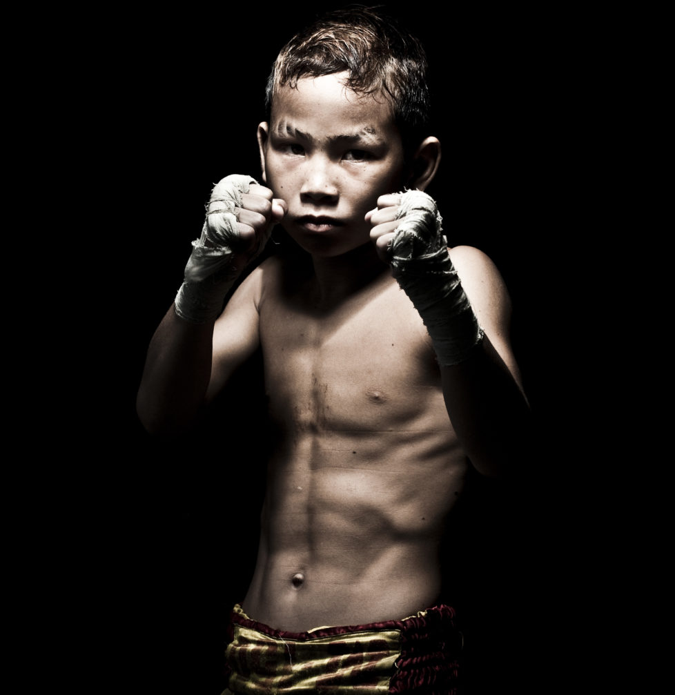 """Muay Thai Kickboxing fighter Suwanaked poses at Sangmorakot gymnasium in Bangkok, Thailand. Muay Thai, also know as """"Art of Eight Limbs"""", is a combat martial art and Thailand's national sport. (Photo by Victor Fraile/Corbis via Getty Images)"""