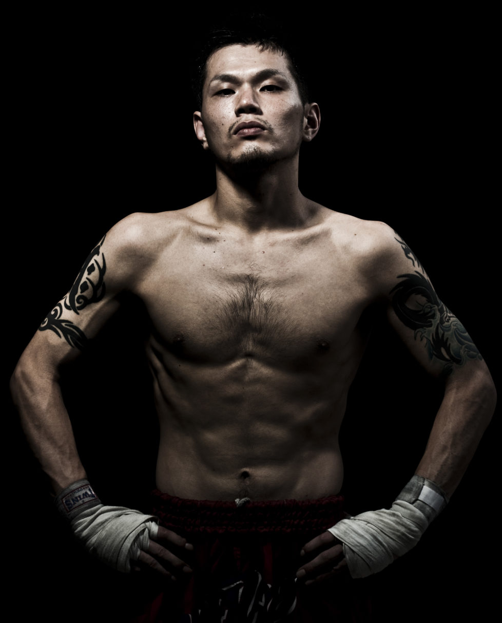 """A muay thai Kickboxing fighter from the Rompo Gym poses in Bangkok, Thailand. Muay Thai, also know as """"Art of Eight Limbs"""", is a combat martial art and Thailand's national sport. (Photo by Victor Fraile/Corbis via Getty Images)"""